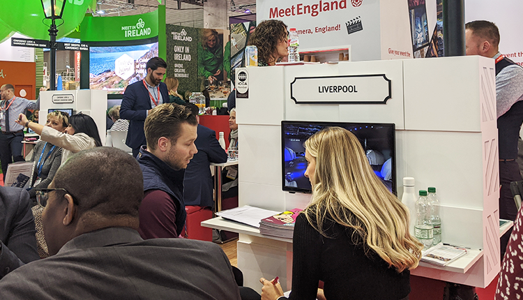 A busy exhibition stand showing one to one meetings
